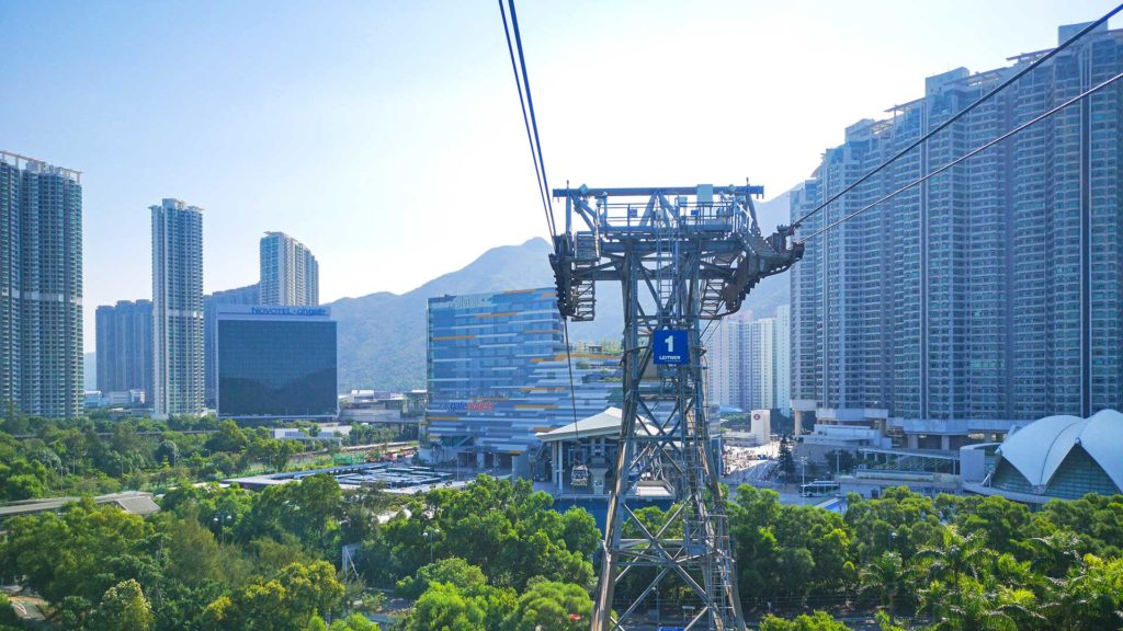 Ride with the Ngong Ping 360 cable car to the Tian Tan Buddha in Hong Kong