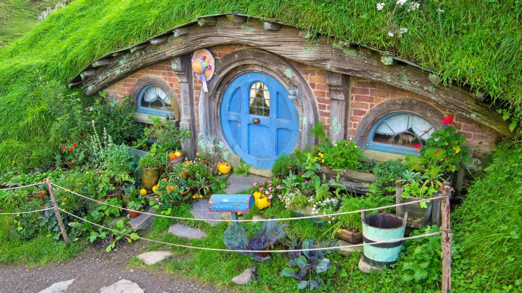 Small Hobbit house with a blue door in Hobbiton, Matamata