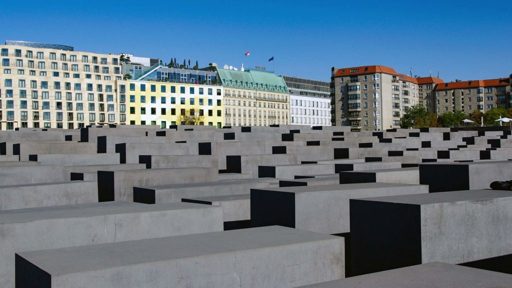 The Memorial to the Murdered Jews of Europe with the Hotel Adlon Kempinski in the background