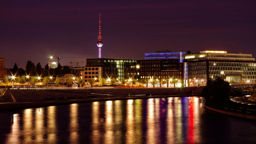 View of the Spree river and the Berlin television tower at night